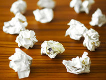 Waste paper on desk Royalty Free Stock Photos