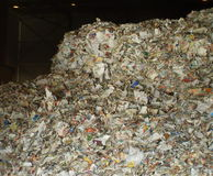 Waste paper for recycling. In a pulp mill royalty free stock photography