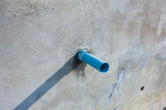 Waste pipe on a wall in sunshine Stock Images