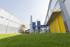 Waste plant green grass. New modern industrial waste plant from the outside. Waste-to-energy plant. Produces electricity and heat directly through combustion Stock Images