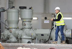 Waste plant high voltage back up diesel power generator. Sofia, Bulgaria - May 29, 2015: An engineer is keeping an eye on the testing of Sofia's second waste Stock Image