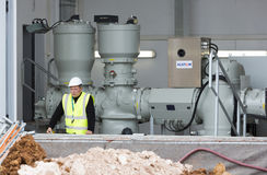 Waste plant high voltage back up diesel power generator. Sofia, Bulgaria - May 29, 2015: An engineer is keeping an eye on the testing of Sofia's second waste Royalty Free Stock Images