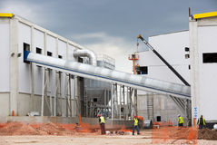 Waste plant outside process workers Royalty Free Stock Photo