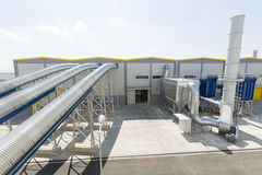 Waste plant pipelines. New modern industrial waste plant pipelines from the outside. Waste-to-energy plant. Produces electricity and heat directly through stock photos