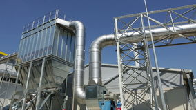 Waste plant pipes sky pan stock footage
