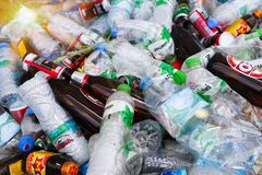 Waste plastic bottles and glass bottles in recycle bin and other types of plastic waste at the recycle factory