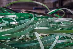 Waste plastic ribbon from automated packaging line Stock Images