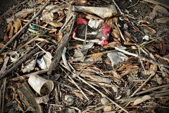 Waste pollution. A pile of trash at the seaside Stock Photos