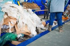 Waste recycling factory. Waste processing plant. Technological process. Recycling and storage of waste for further disposal. Business for sorting and processing Stock Image
