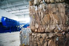Waste recycling factory. Waste processing plant. Technological process. Recycling and storage of waste for further disposal. Business for sorting and processing Royalty Free Stock Image