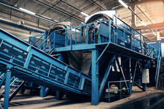 Waste processing plant. Technological process. Recycling and storage of waste for further disposal. Business for sorting. Waste processing plant. Recycling and Royalty Free Stock Photos