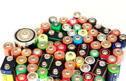 Waste recycling alkaline batteries, reuse, garbage disposal. Environment and ecology concept. Used battery and electronic waste stock photo
