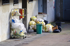 Waste for recycling. Basket with waste and waste bags prepared for recycling Stock Images