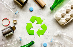 Waste and recycling symbol in eco care on stone top view Stock Photo