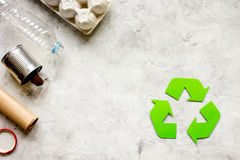 Waste and recycling symbol in eco care on stone top view Stock Photos