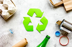 Waste and recycling symbol in eco care on stone top view Royalty Free Stock Photography
