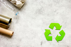 Waste and recycling symbol in eco care on stone top view Royalty Free Stock Photos