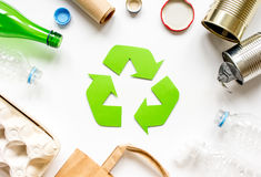 Waste recycling symbol with garbage on white background top view. Waste recycling eco symbol with garbage disposal on white table background top view Stock Image