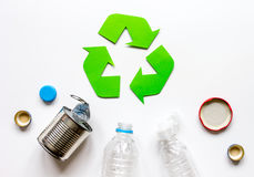Waste recycling symbol with garbage on white background top view mock up. Waste recycling eco symbol with garbage disposal on white table background top view Royalty Free Stock Photo