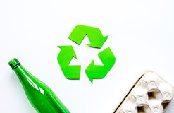 Waste recycling symbol with garbage on white background top view mock up. Waste recycling eco symbol with garbage disposal on white table background top view Royalty Free Stock Photos