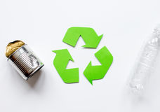 Waste recycling symbol with garbage on white background top view mock up. Waste recycling eco symbol with garbage disposal on white table background top view Royalty Free Stock Images