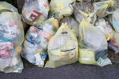 Waste recycling with yellow bag Stock Photos