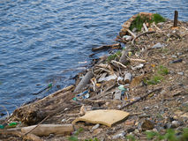 Waste on riverbank. Ruined human living environment on riverbank Royalty Free Stock Photos
