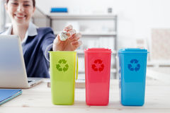 Waste separate collection. And recycling in the workplace, office worker sorting garbage using different trash bins Stock Photos