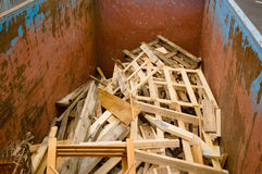 Waste separation. Container with sorted wooden waste. The container is only filled to the bottom so there is room for more waste. Wooden waste is often used as stock photo