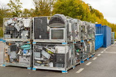 Waste separation. Netted bins full of discarded electronics waste waiting to be transported to the recycle plant for further processing. Blue containers in stock images