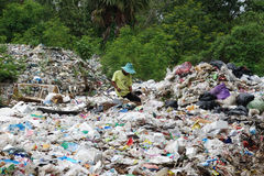 Waste separation by poor people Royalty Free Stock Images