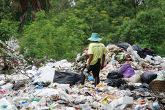 Waste separation by poor people Royalty Free Stock Photography