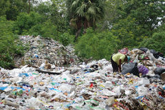 Waste separation by poor people Royalty Free Stock Image