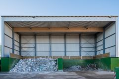 A waste is sorted and disposed of at a recycling yard royalty free stock images