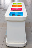 Waste sorting bins. Four colors for plastic, glas, papier and rest stock photo