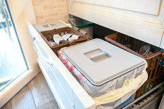 Waste sorting drawer recycling kitchen home chores.  Stock Photo