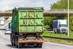 Waste tipper lorry truck on uk motorway in fast motion.  royalty free stock photography