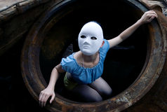 Waste tire and masked female Stock Images