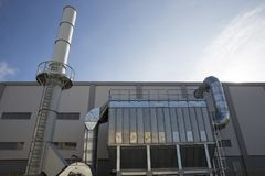 Waste-to-energy facility outside. New modern industrial waste plant from the outside. Waste-to-energy plant. Produces electricity and heat directly through stock images