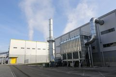 Waste-to-energy plant. Waste-to-energy or energy-from-waste is the process of generating energy in the form of electricity or heat from the primary treatment of stock photo