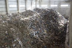 Waste-to-energy waste garbage trash. Waste-to-energy or energy-from-waste is the process of generating energy in the form of electricity or heat from the primary stock image