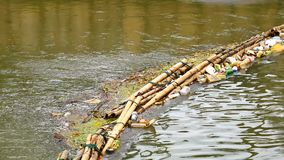 Waste trap device before flowing into the sea Made from bamboo. Phuket, Thailand, Nov 2017 : The waste trap device before flowing into the sea Made from bamboo stock video footage