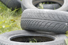 Waste Tyres Dumped in Grassland. Royalty Free Stock Image