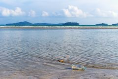 Waste water bottles that float on the beach side, environmental pollution problems from human beings. Concept safe nature stock photography