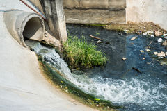 Waste water drains. From concrete pipe Stock Photos