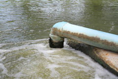 Waste water flow from water pipe Stock Photo