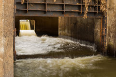 Waste Water flowing from city drain pipe. Royalty Free Stock Photography