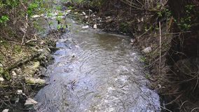 Waste water flowing and polluting environment. Royalty Free Stock Images