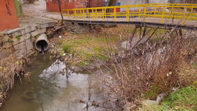 Waste water, pollution and garbage in urban canal. stock footage