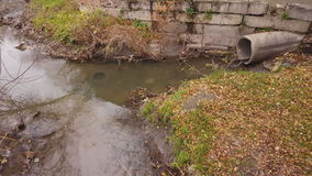 Waste water, pollution and garbage in urban canal. stock video footage